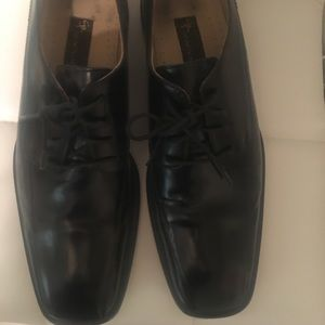 Stacy Adams black Oxford shoes.
